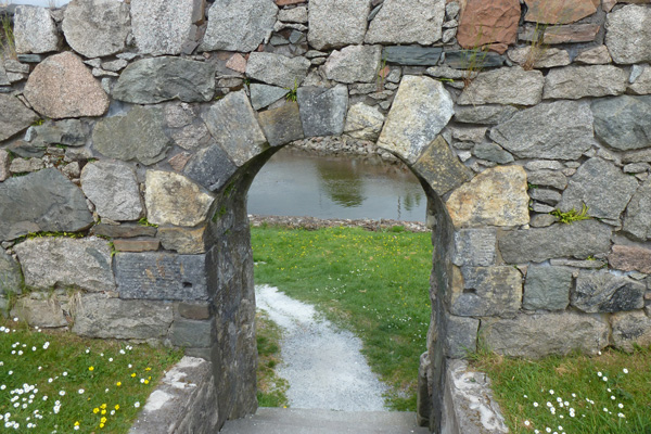 Stone archway leading to the beach