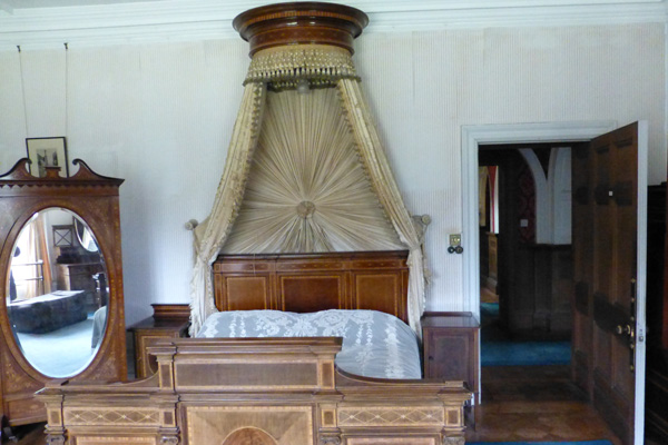 Sir George's bedroom with inlaid mahogany bed