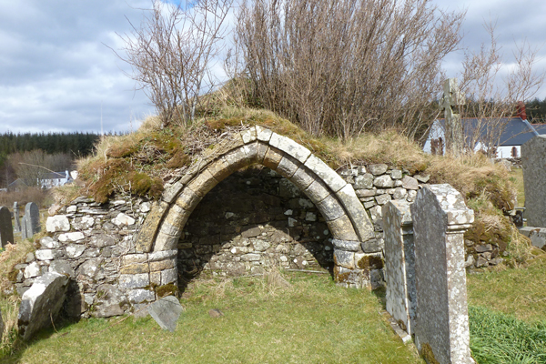 The medieval stone archway of a former church