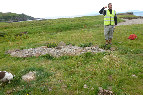A member of The Ardnamurchan Transitions Project talking about the Viking Boat Burial Site during an open day in 2012