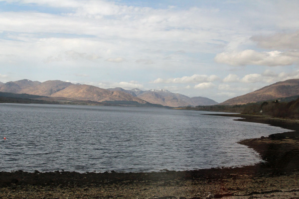 The train passes close by the shore of Loch Eil, a sea loch joining into Loch Linnhe