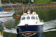 The Ardnamurchan Charters boat picking up passengers from Salen