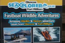 A sign for Seaxplorer Fasboat wildlife trips in Glencoe and Fort William