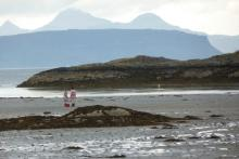 Looking out from Samalaman Beach to Eigg and Rum