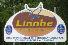 The sign for Linnhe Lochside Holiday Park