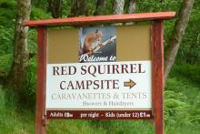 The sign for The Red Squirrel Campsite
