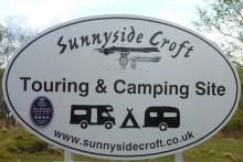 The sign for Sunnyside Croft Touring and Camping Site