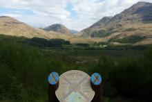 The interpretation board recounts the historic events associated with the laird of Glen Ure