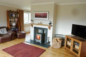 Lapwing Rise - Lounge with wood burning stove