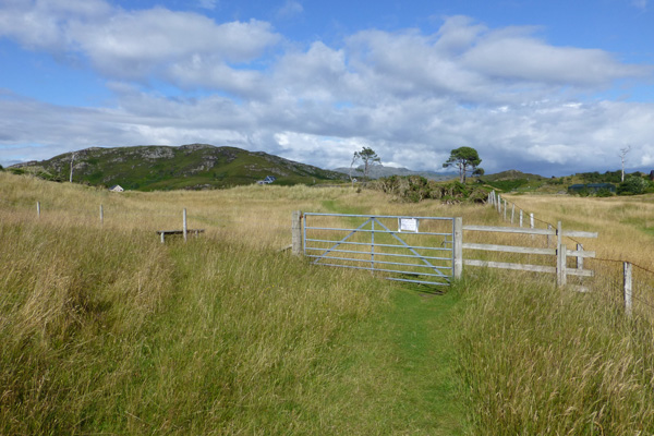 Pass through the metal gate (or over the stile) to join a grassy path