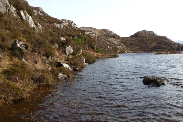 Path skirting the dammed lochan