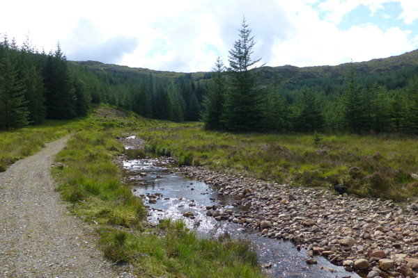 The path skirts by the little stream Allt Coire an t-Suidhe