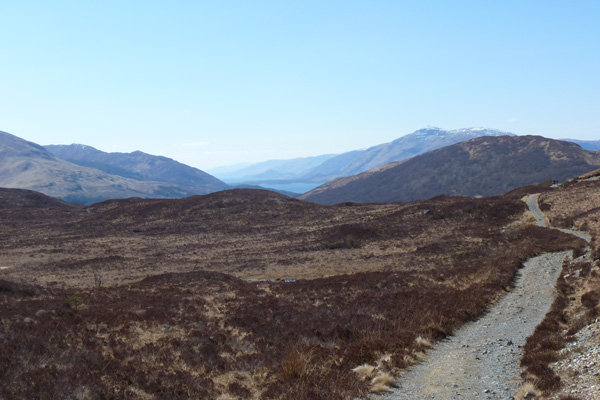 Crossing a lovely section heathland with fine views of the Nevis Rangee