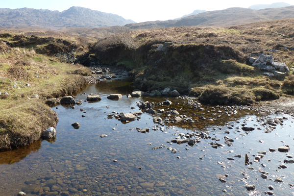Stepping stones over the stream just before Glendrian village