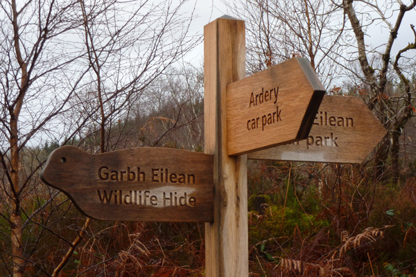 signs to the two car parks and otter hide