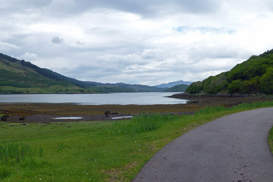 The private road pases close to the shoreline of Loch Teacuis