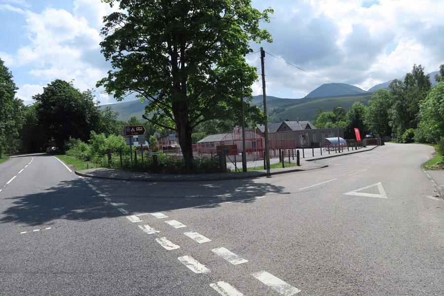 Turn right just before Roy Bridge School