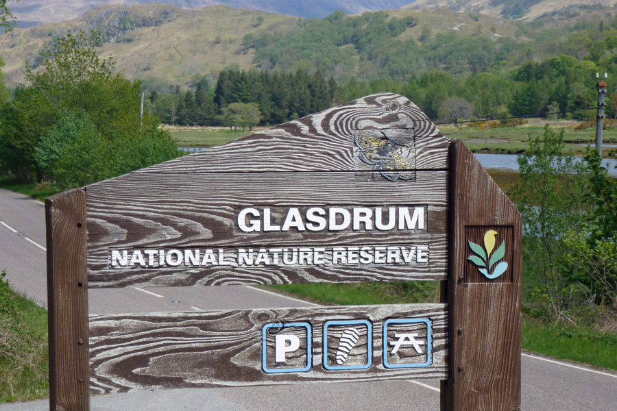 The sign for Glasdrum National Nature Reserve visible from the road