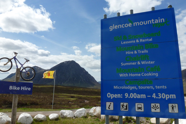 The sign for The Glencoe Mountain Resort and Ski Lift on the A82